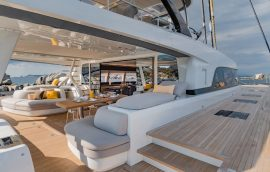 Aft deckwith cushioned sofas on Lagoon 77