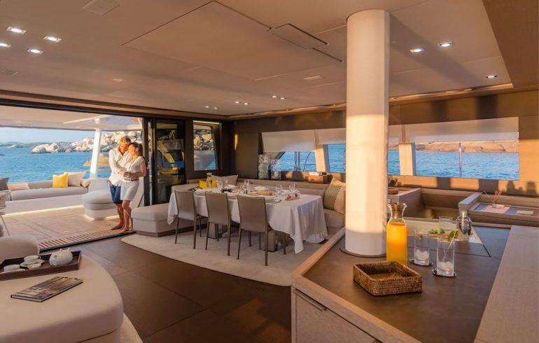 Main saloon with dinning area on board Lagoon 77