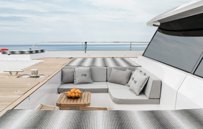 Bow deck with large cushioned sofa on catamaran Sunreef 60