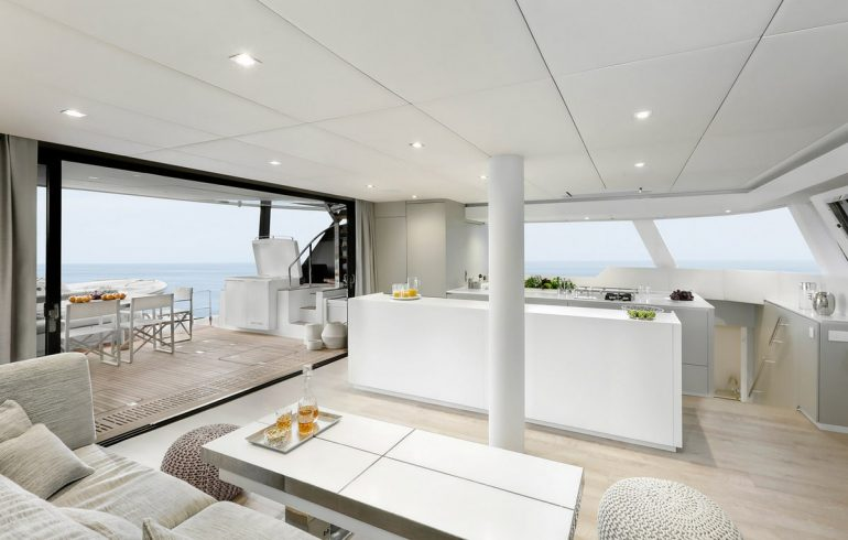 Saloon with dinning table on Sunreef 60 catamaran