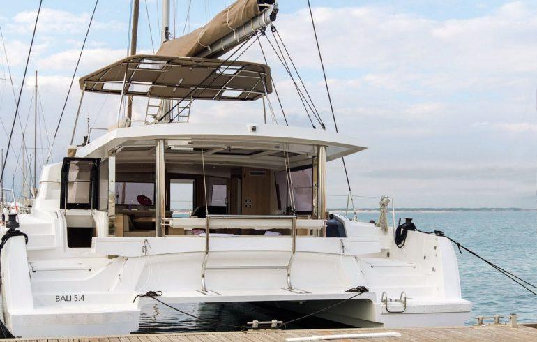 Rental catamaran bali 5.4 docked in marina with visible aft deck