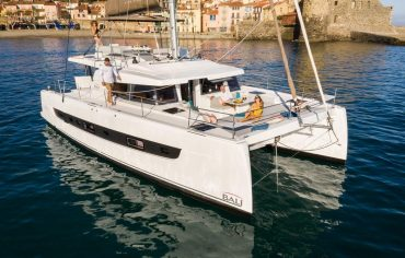 Bow deck of bali 4.6 have cocktail table and sun mattresses for sunbathing